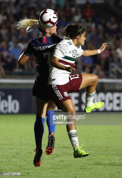 Abby Dahlkemper of USA competes for a ball against Rebeca Bernal of Mexico during the Group A CONCACAF Women's Championship at WakeMed Soccer Park on...