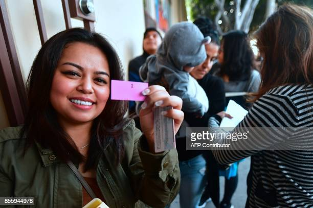 Abby holds her ticket after being first in line with other Deferred Action for Childhood Arrivals recipients waiting in line at the Coalition for...