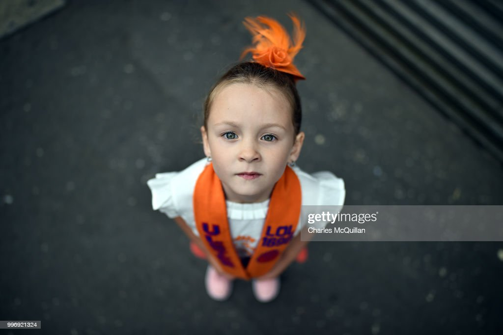 Abby Preston, aged five poses for a photograph during the annual 12th of July Orange march and demonstration taking place on July 12, 2018 in Belfast, Northern Ireland. The marches across the province celebrate King William of Orange's victory over the Catholic King James at the Battle of the Boyne in 1690.