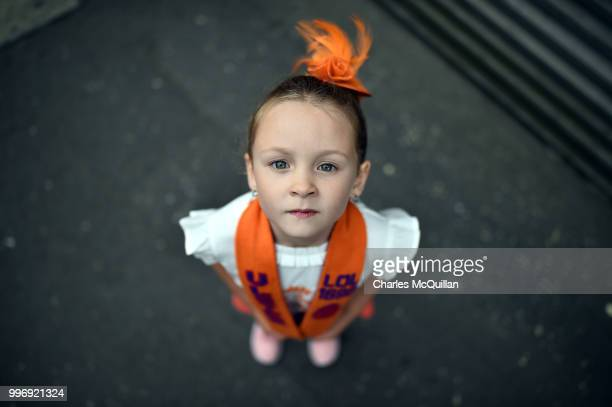 Abby Preston aged five poses for a photograph during the annual 12th of July Orange march and demonstration taking place on July 12 2018 in Belfast...