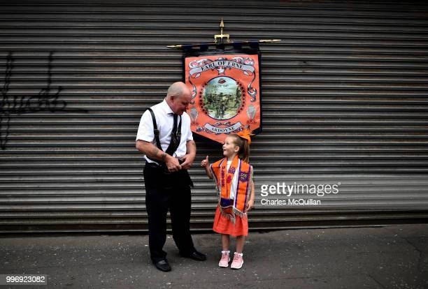 Abby Preston aged five watches on during the annual 12th of July Orange march and demonstration taking place on July 12 2018 in Belfast Northern...