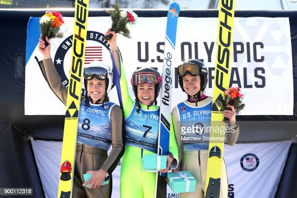 Abby Ringquist Sarah Hendrickson and Nita Englund celebrate on the medals podium after the US Womens Ski Jumping Olympic Trials on December 31 2017...