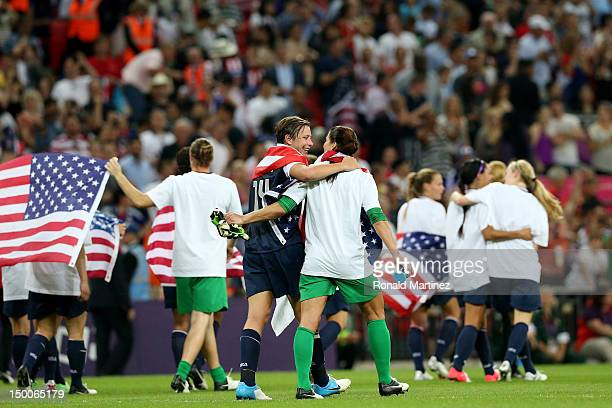 Abby Wambach and goalkeeper Hope Solo celebrate with the American flag after defeating Japan by a score of 21 to win the Women's Football gold medal...
