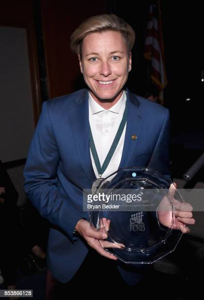 Abby Wambach attends the 32nd Annual Great Sports Legends Dinner To Benefit The Miami Project/Buoniconti Fund To Cure Paralysis at New York Hilton...