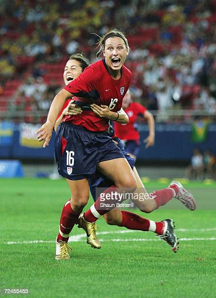 Abby Wambach celebrates with Julie Foudy of the USA her winning goal in extra time to beat Brazil 21 in the women's football gold medal match on...