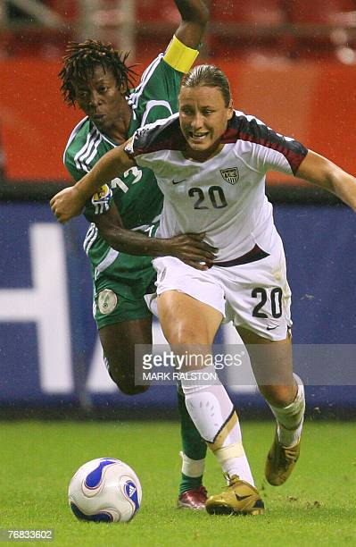 Abby Wambach from the United States is chased by Christie George from Nigeria during their 2007 FIFA Women's World Cup football tournament Group B...
