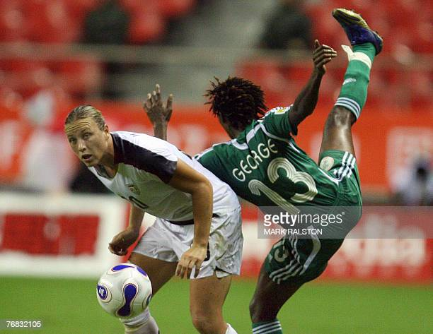Abby Wambach from the US clashes with Nigerian player Christie George during their 2007 FIFA Women's World Cup football tournament Group B match at...