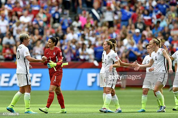 Abby Wambach Hope Solo and Christie Rampone of the United States celebrate with teammates after the 10 victory against Nigeria in the Group D match...