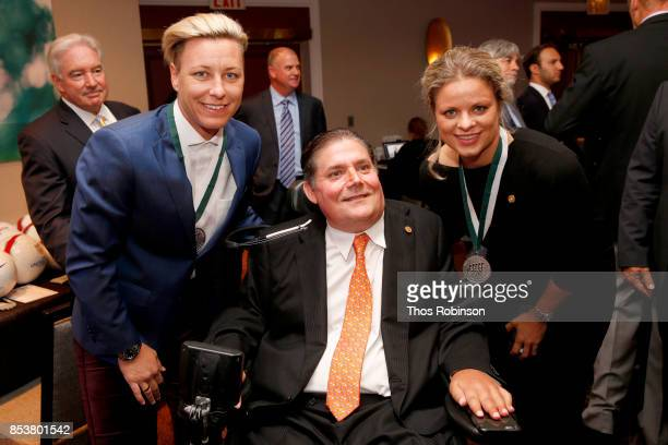 Abby Wambach Marc Buoniconti and Kim Clijsters attend the 32nd Annual Great Sports Legends Dinner To Benefit The Miami Project/Buoniconti Fund To...