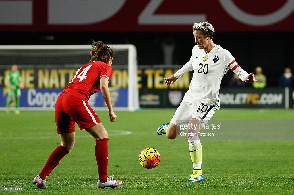 Abby Wambach #20 of the United States attempts a shot against Zhao Rong #14 of China during the second half of the women's soccer match at University of Phoenix Stadium on December 13, 2015 in Glendale, Arizona. USA defeated China 2-0.