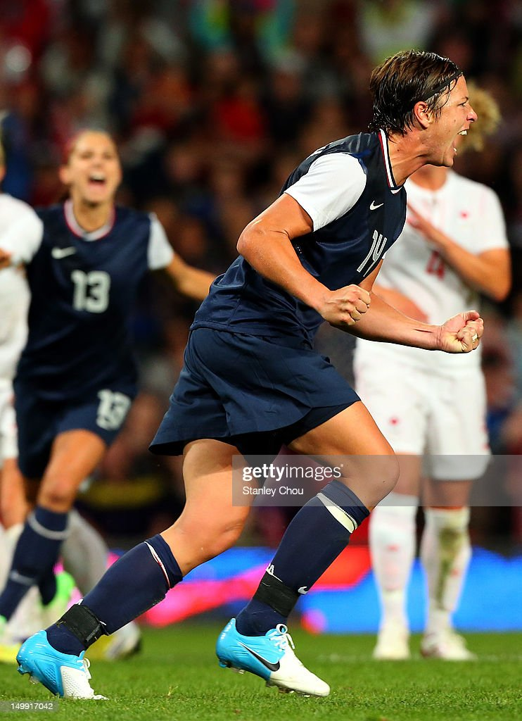 Abby Wambach of the United States celebrates after she converted the penalty during the Women's Football Semi Final match between Canada and USA, on Day 10 of the London 2012 Olympic Games at Old Trafford on August 6, 2012 in Manchester, England.