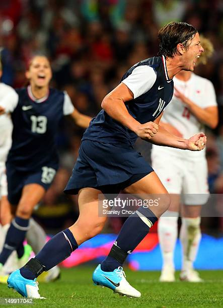 Abby Wambach of the United States celebrates after she converted the penalty during the Women's Football Semi Final match between Canada and USA on...