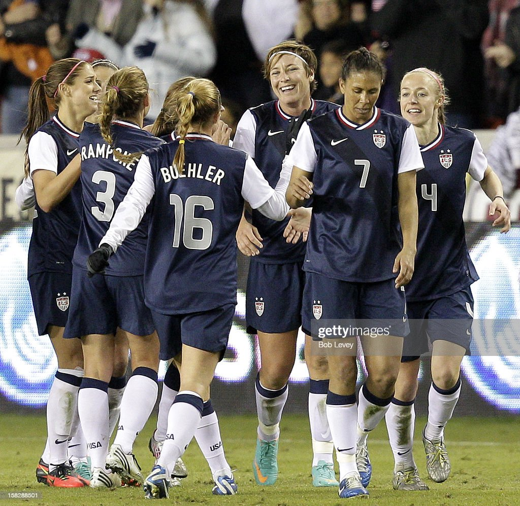 Abby Wambach #14 of the United States celebrates her second goal of the game with her teammates in the second half at BBVA Compass Stadium on December 12, 2012 in Houston, Texas. Wambach's goal was her 150th international goal. USA won 4-0.