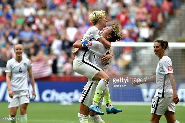 Abby Wambach of the United States celebrates with Megan Rapinoe after Wambach scores a goal in the first half against Nigeria in the Group D match of...
