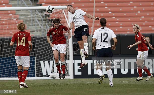 Abby Wambach of the United States goes up for a header in front of Saskia Bartusiak of Germany during the game on May 22 2010 at Browns Stadium in...