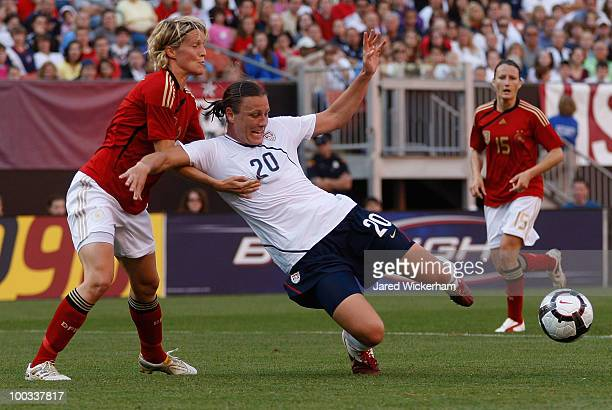 Abby Wambach of the United States is fouled by Saskia Bartusiak of Germany during the game on May 22 2010 at Browns Stadium in Cleveland Ohio
