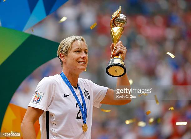 Abby Wambach of the United States of America holds the World Cup Trophy after their 52 over Japan in the FIFA Women's World Cup Canada 2015 Final at...