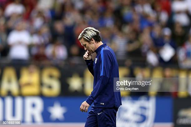 Abby Wambach of the United States walks off the field following the women's soccer match against China at the MercedesBenz Superdome on December 16...