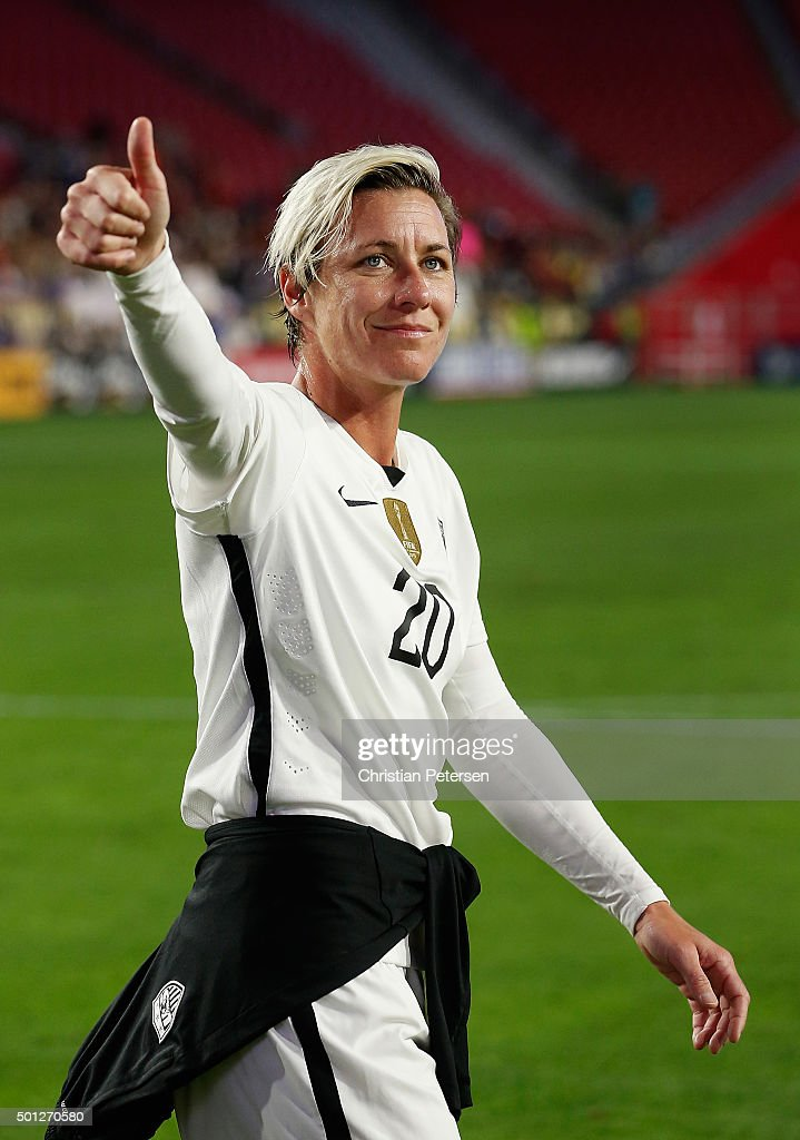 Abby Wambach #20 of the United States waves to fans as she walks off the field following the women's soccer match against China at University of Phoenix Stadium on December 13, 2015 in Glendale, Arizona. USA defeated China 2-0.