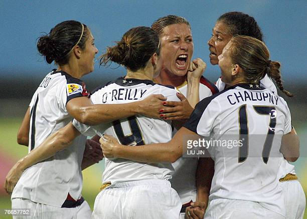 Abby Wambach of the US celebrates a goal with teammates during their group B match against North Korea of the Women's Football World Cup 2007 in...