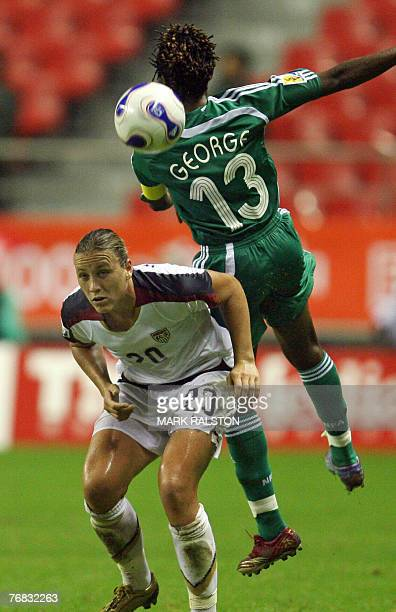 Abby Wambach of the US clashes with Nigerian player Christie George during their 2007 FIFA Women's World Cup football tournament Group B match at the...