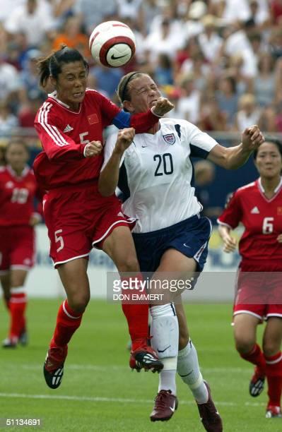 Abby Wambach of the US goes for the ball against China's Fan Yunjie during a friendly match between the China National Women's Soccer team and the US...