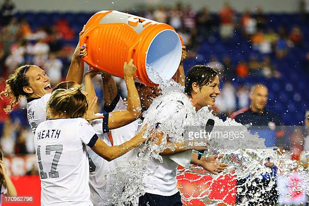 Abby Wambach of the USA gets a Gatorade bath by her teamates after a 50 win against Korea Republic after Wambach broke Mia Hamm's alltime...
