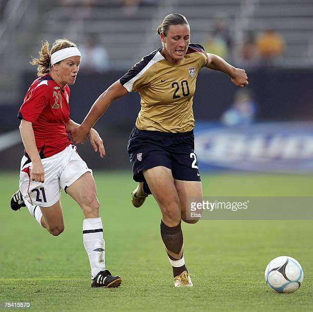 Abby Wambach of the USA heads down the field as Lene Storlokken of Norway during the Women's World Cup SendOff Series on July 14 2007 at Rentschlier...