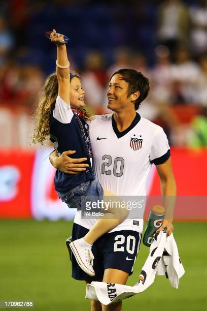 Abby Wambach of the USA holds Riley Rampone daughter of Christie Rampone after a 50 win against Korea Republic in which Wambach broke Mia Hamm's...