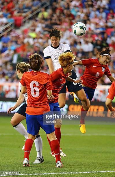 Abby Wambach of the USA passes Mia Hamm in alltime International total goals scored with her159th International goal against Korea Republic during...