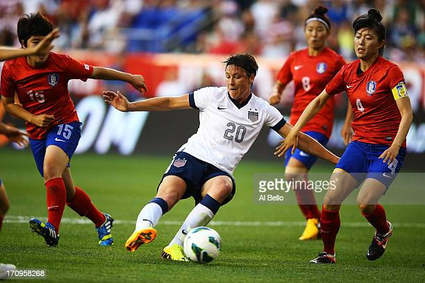 Abby Wambach of the USA scores her 157th International goal against Kim Narae and Shim Seoyeon of Korea Republic during the first half of their game...