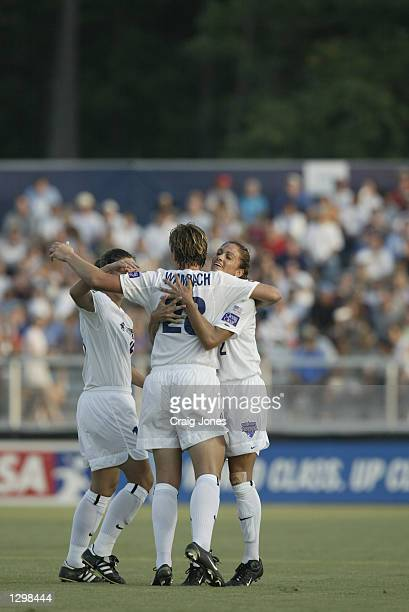Abby Wambach of the Washington Freedom celebrates with teammates against the Carolina Courage during the WUSA game on July 31 2002 at SAS Stadium in...
