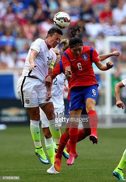 Abby Wambach of United States and Seoyeon Shim of South Korea fight for the ball during an international friendly match at Red Bull Arena on May 30...
