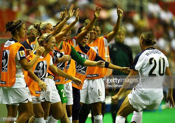 Abby Wambach of United States celebrates with her teammates on the substitutes bench after scoring her secoond goal during the Women's World Cup 2007...
