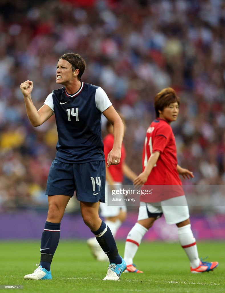 Abby Wambach #14 of United States reacts in the first half alongside Shinobu Ohno #11 of Japan during the Women's Football gold medal match on Day 13 of the London 2012 Olympic Games at Wembley Stadium on August 9, 2012 in London, England.