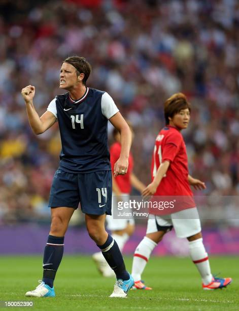 Abby Wambach of United States reacts in the first half alongside Shinobu Ohno of Japan during the Women's Football gold medal match on Day 13 of the...