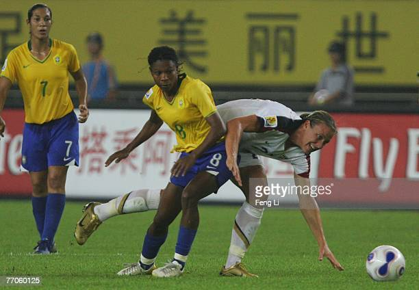 Abby Wambach of USA battles for the ball with Formiga of Brazil during the Womens World Cup 2007 Semi Final match between USA and Brazil at Hangzhou...