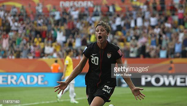 Abby Wambach of USA celebrates after scoring her team's equalizing goal during the FIFA Women's World Cup 2011 Quarter Final match between Brazil and...
