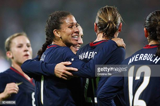 Abby Wambach of USA celebrates after scoring her team's first goal with team mates during the Women's International friendly match between Germany...
