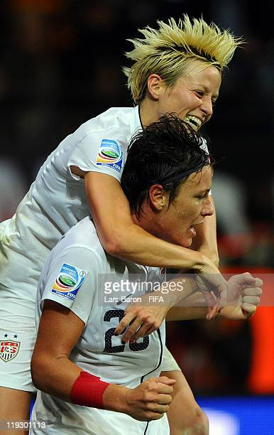 Abby Wambach of USA celebrates with team mate Megan Rampinoe after scoring her teams second goal during the FIFA Women's World Cup Final match...