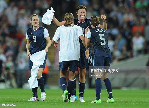 Abby Wambach of USA hugs Kelley O'Hara and Alex Morgan after winning the USA vs Japan Final match in the Women's Soccer Competition as part of the...