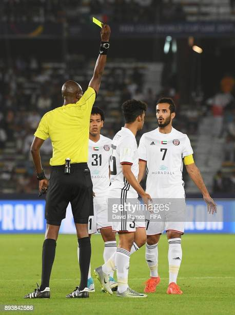 Abdalla Ramadan of Al Jazira is shown a yellow card by referee Malang Diedhiou during the FIFA Club World Cup UAE 2017 third place play off match...