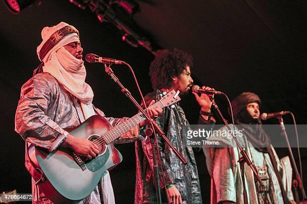 Abdallah Ag Alhousseyni Said Ag Ayad Ibrahim Ag Alhabib of Tinariwen perform at the Lunar Festival on June 5 2015 in TanworthinArden United Kingdom