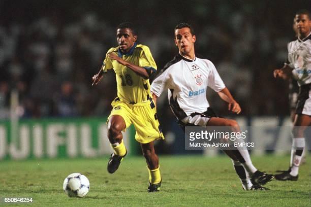 Abdallah Al Karni of Al Nassr gets ahead of Marcos Senna of Corinthians