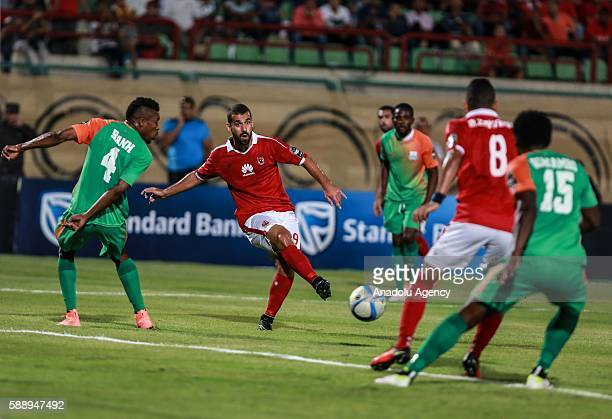 Abdallah El Said of Al Ahly in action against Adama Bahn of ZESCO United during the Group A match of CAF Champions League between Egyptian team Al...
