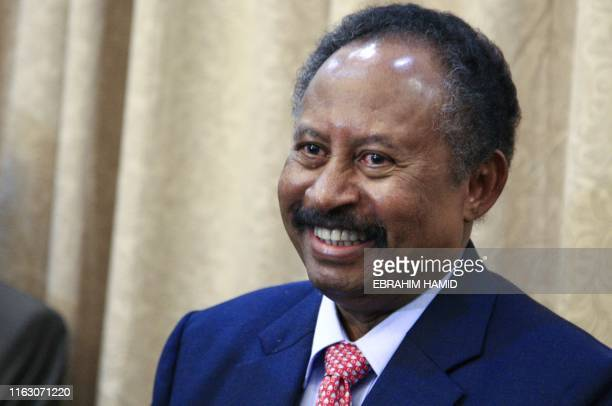 Abdallah Hamdok is pictured after being sworn in as Sudan's interim prime minister in the capital Khartoum on August 21 2019 Hamdok was sworn in...