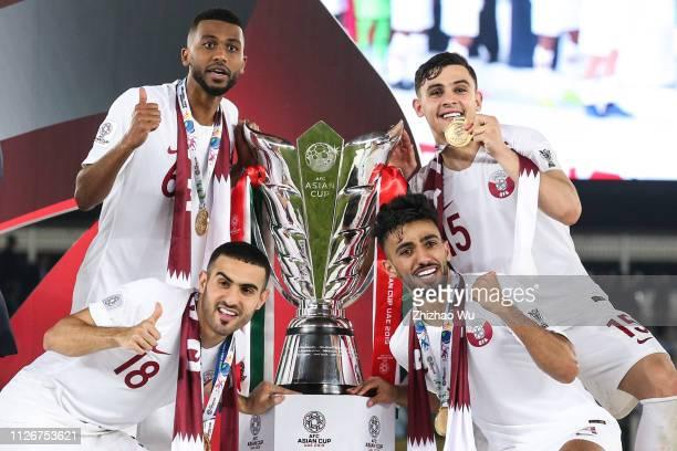Abdel Aziz Hatim and Tarek Salman and Bassam Alrawi and Abdulkareem Salem AlAli of Qatar celebrates their victory after the AFC Asian Cup final match...