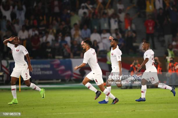 Abdel Aziz Hatim of Qatar celebrates scoring a goal to make it 0-2 during the AFC Asian Cup final match between Japan and Qatar at Zayed Sports City...