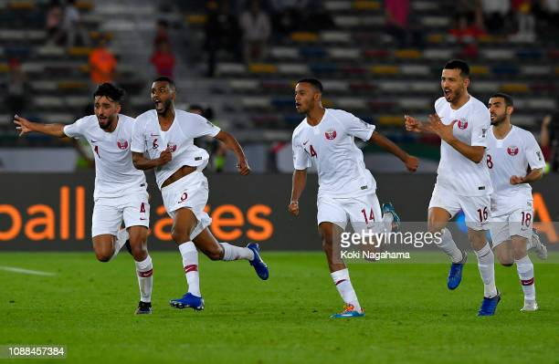 Abdel Aziz Hatim of Qatar celebrates with teammates after he scores his sides first goal during the AFC Asian Cup quarter final match between South...