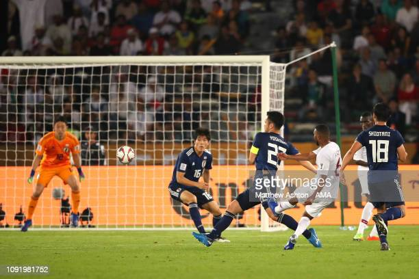 Abdel Aziz Hatim of Qatar scores a goal to make it 02 during the AFC Asian Cup final match between Japan and Qatar at Zayed Sports City Stadium on...